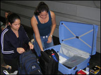 The Lopez family transferring items from their hand luggage