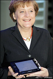 German Chancellor Angela Merkel demonstrates the Q1
