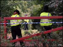 Police seal off a wooded area near Micklefield Road in High Wycombe