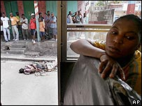 Una mujer haitiana mira hacia otro lado para no ver un cadáver en la calle