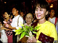 Burmese opposition leader Aung San Suu Kyi walks with friends and family
