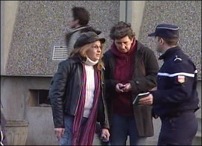 A man and a woman talk to a policeman
