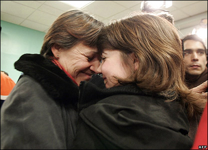 A young girl kisses her mother after being released