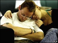 Passengers sleep in Gatwick Airport, London