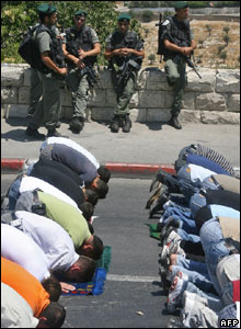 Palestinians prevented from reaching Jerusalem's al-Aqsa mosque pray on the street on 11 August.