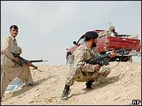 Troops of Pakistan paramilitary forces take position in the Dera Bugti