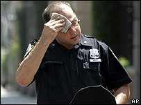 A New York City police officer wipes his face during the city's heatwave
