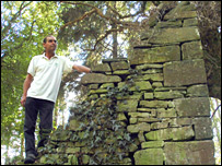 Keith Stockdale inspects one of the ruins