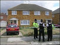 Police guard a house on Walton Drive, High Wycombe