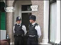 Police guard a home in Walthamstow