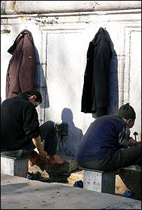 Turks washing their feet before praying at the mosque