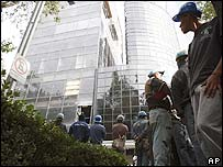 Mexicans wait outside an evacuated building