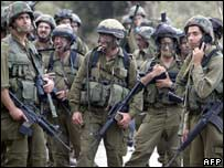 Israeli troops await the order to advance near the Israel-Lebanon border on 12 August