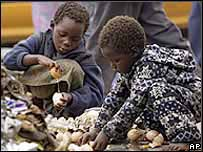 Children scavenge for food in Zimbabwe