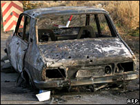 Burnt out car in Lebanon (12 Aug)