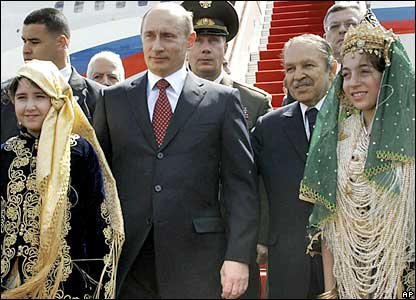 Russian President Vladimir Putin and Algerian President Abdelaziz Bouteflika at a welcome ceremony in Algiers for Mr Putin on Friday
