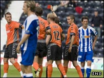 Lee Miller (left) is ordered off at Rugby Park