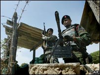 Two Sri Lankan soldiers man a checkpoint in Jaffna in file photo from June