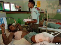 A Sri Lankan soldier lies wounded in a ward of a hospital in Anuradhapura after being airlifted out of areas of fighting