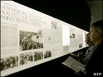 People look at part of the exhibition which covers the expulsion of Poles from territory annexed by Germany