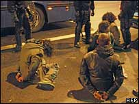 Handcuffed students on the pavement near Sorbonne, Paris