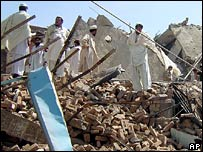 Villagers search through debris after Friday's overnight operation by Pakistani forces near Miranshah