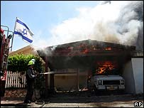 Israeli fire-fighter tackles blaze after rocket attack on Kiryat Shmona