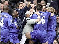Chelsea players celebrate Gallas's winner