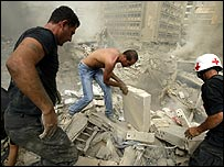 Rescuers search through rubble in Beirut after Israeli bombing on 13 August