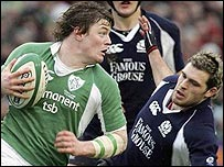Ireland skipper Brian O'Driscoll evades Sean Lamont