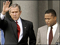 President George W Bush with former adviser Claude Allen