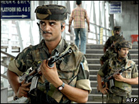 Indian army soldiers patrol at the Guwahati Railway Station, in the capital city of India's north-eastern state of Assam