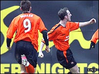 Mark Kerr celebrates his goal at Tannadice