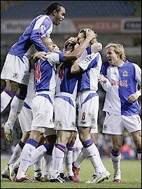 Blackburn congratulate captain Andy Todd after his opener against Aston Villa