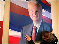 Woman kissing poster of former Yugoslav President Slobodan Milosevic