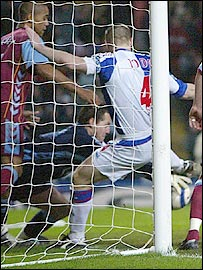 Blackburn captain Andy Todd scrambles the ball home to put his side ahead