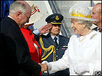 The Queen (right) greets Prime Minister John Howard
