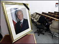 Portrait of Slobodan Milosevic with black mourning ribbon at his party's HQ in Belgrade