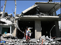 Man walks through rubble of Gaza home