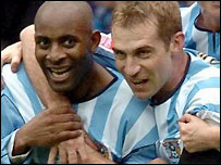 Dele Adebola (left) celebrates Coventry's second goal