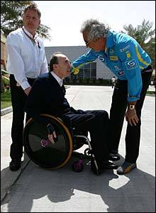Flavio Briatore chats with Sir Frank Williams in the paddock