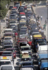 Lebanese cars wait to cross a destroyed bridge south of Sidon