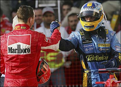 Michael Schumacher congratulates Fernando Alonso