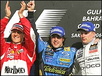 Fernando Alonso celebrates his Bahrain Grand Prix victory, flanked by runner-up Michael Schumacher (left) and third-placed Kimi Raikkonen