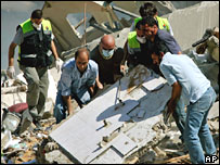 Lebanese civil defence personnel and civilians search for victims, 14 August