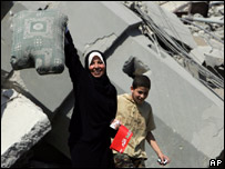 Lebanese woman finds her own sofa cushion among rubble in south Beirut