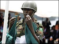Nigerian soldier lowers the flag