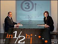 Silvio Berlusconi and Lucia Annunziata pose for the camera before the interview