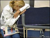 A woman waiting at Heathrow Airport