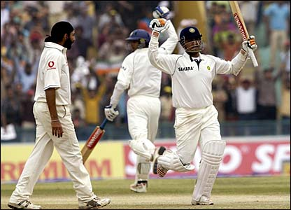 Monty Panesar looks on as Virender Sehwag celebrates